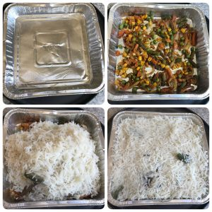 tranferring the vegetables and rice to baking tray for baked vegetable biryani